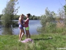 Lesbian teens pleasing pussies at the lake