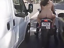 Curvy woman's naked motorbike ride