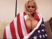 Hot American chick with huge boobs strips