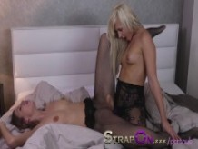 StrapOn Lesbians in black fishnets fuck with purple strapon dildo