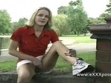Pretty British lady in a skirt flashes at the park