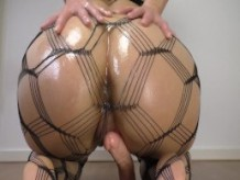 Big Oiled Ass Rides a Dildo